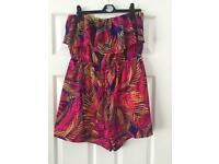 Muliti coloured tropical design bandeau playsuit from pretty little thing. Size 14.