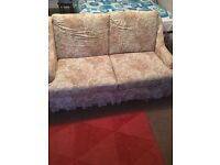Floral patterned, sofa with small double pull out bed + extra mattress topper