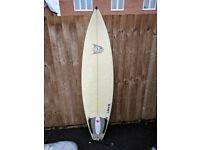 6'4 Jon Harvey thruster surfboard and board cover - good board for most waves - great condition!