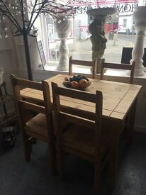 DINING TABLE AND 4 CHAIRS SET. PINE. NICE LOOKING.