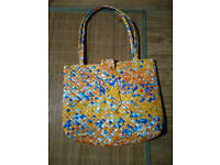 Bag and purse made from recycled juice cartons