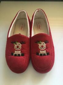 Woman's red reindeer slippers, size 7.