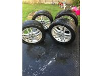 set of four vauxhall 5 stud 16in alloys with very good tyres