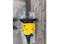 Petrol hege trimmer and chain saw
