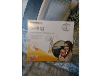 Medela Swing Electric Breast Pump with 2 Phase Technology: Only used once, excellent condition