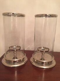 A pair of Laura Ashley hurricane lamps