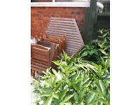 Outdoor hardwood table and 4 chairs (folds flat for ease of storage)