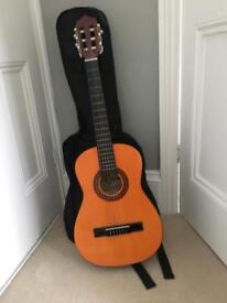 Children's acoustic guitar and case