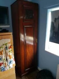 Tall slim mahogany wardrobe