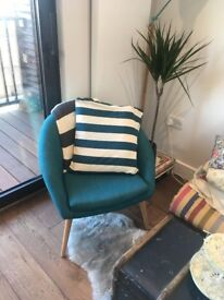 Made armchair in teal