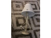 Vintage style cream lamp with cream lampshade and hanging crystals.