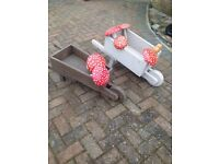 Ornamental wheel barrows and toadstools