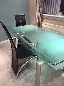 harveys noir black glass extending dining table 4 upholstered