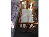 Crib with mattress.. swings to the sides but also stays still.. brand new