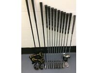 Full set of golf clubs with carry bag.