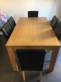 Light wood table with 6 black faux leather seats