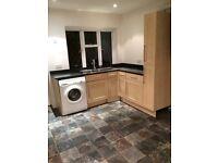 Kitchen units, work surface, sink & tap £100