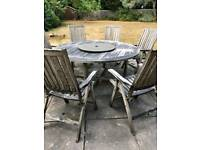 Solid wood garden table with 8 matching chairs and cushions