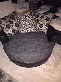Round swivel sofa.