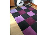 Rug in purple and black