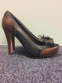Navy and brown high heel brogue with tassel