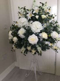X2 artificial flowers on adjustable stands used for aisle decorations on either side