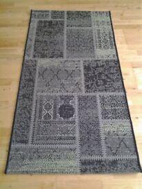 Patchwork green rug