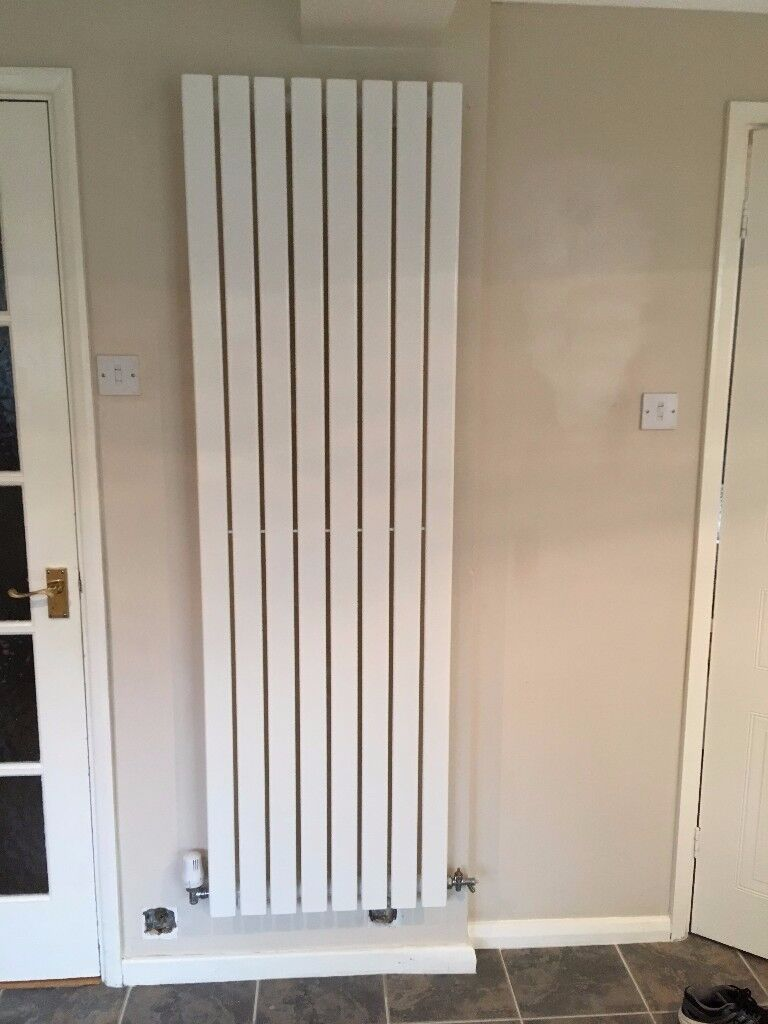 White vertical, flat panel designer radiator