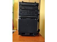 KARAOKE MACHINE - PLAYS AUDIO CASSETTE TAPES. GOOD CONDITION. INCLUDES 4 TAPES