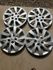 THESE ARE WHEEL COVERS NOT RIMS    BRAND NEW TAKE OFF HYUNDAI ELANTRA FACTORY OEM 16 INCH WHEEL COVER SET OF FOUR.