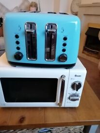 Swan microwave and 4 slice toaster.