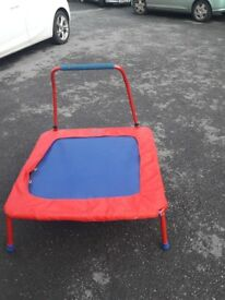 Childs trampoline for indoor/outdoor use. complete with handle