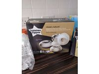 Electric breast pump used once comes with hand he'll breast pump to bottles
