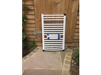 White curved towel radiator