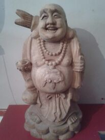 Carved wooden Buddha sculpture