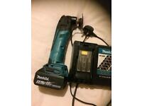 Makita multi tool with 5 amp battery and charger