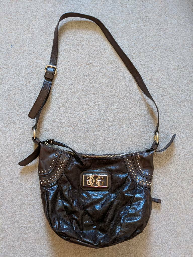 Guess cross body bag brown with gold logo and studs   in Wokingham ... cf0cf63e0a