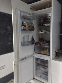AEG fridge freezer integrated with fascias and pantry unit
