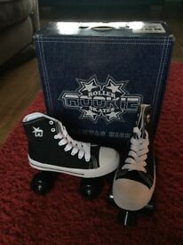 Brand new hi top canvas Rookie roller skates size 2