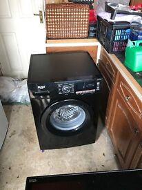2 month old 9kg black bush washing machine