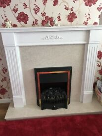 Electric fire with wooden/marble surround.