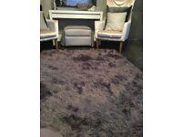 Grey Sparkly Deep pile rug.