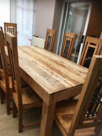 Wooden dining table plus 8 wooden chairs