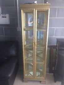 Tall glod & glass unit with internal light
