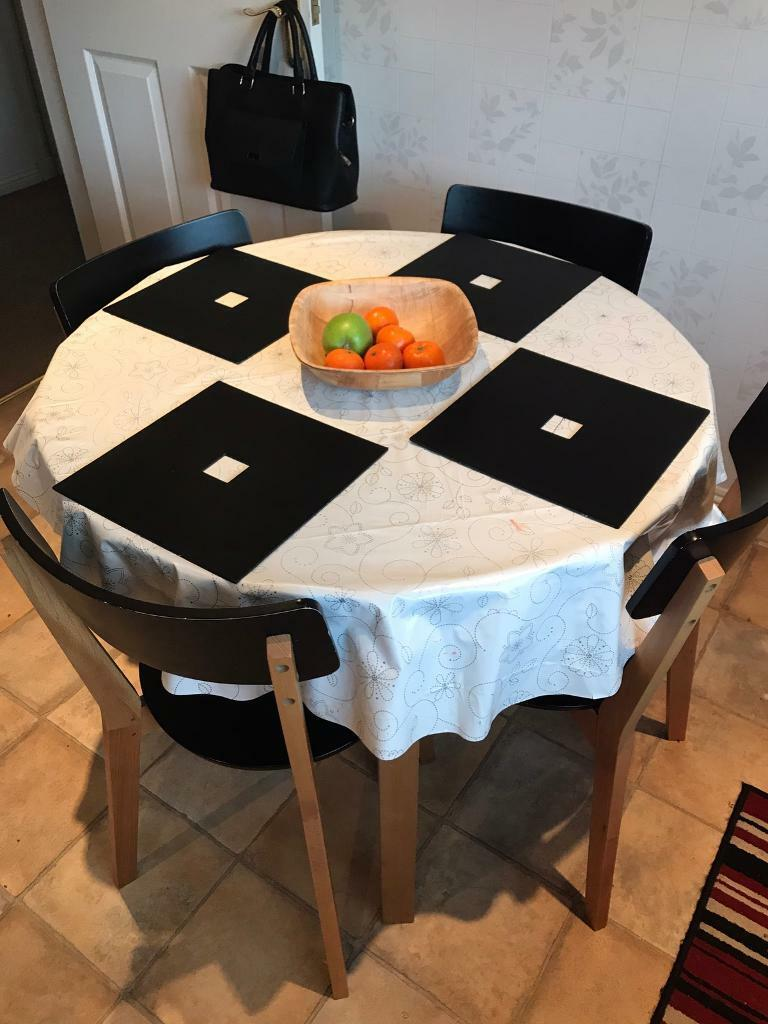 Small Black Table and Four Chairs