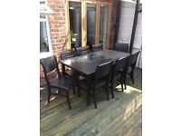 Large hardwood garden table and 8 chairs