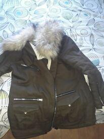 Ladies size 8 coat with fur