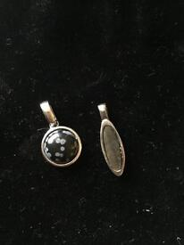 2 silver and gemstone pendants