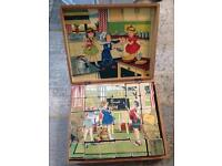 Beautiful vintage wooden puzzle in box. All sides of cubes make different scene. SOLD
