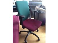 Well-kept office chair with adjustable hand rest